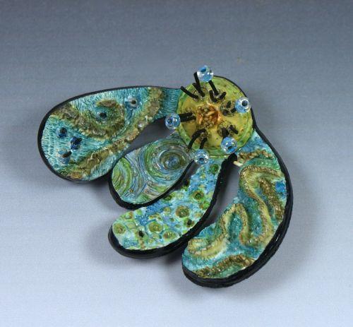 broche fleur colorée